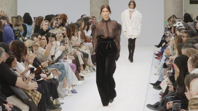 bella hadid at milan fashion week women's fall / winter 2020 - 2021 - max mara on february 20, 2020 in milan, italy. - sfilata video stock e b–roll