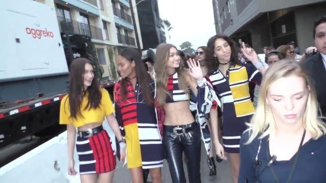 bella hadid joan smalls gigi hadid outside the tommyland tommy hilfiger spring 2017 fashion show at venice beach in celebrity sightings in los angeles - joan smalls stock videos & royalty-free footage