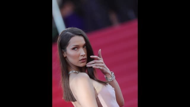 Bella Hadid poses for photographers at the 'Ash Is The Purest White ' red carpet during the 71st Cannes Film Festival on May 8 2018 in Cannes France