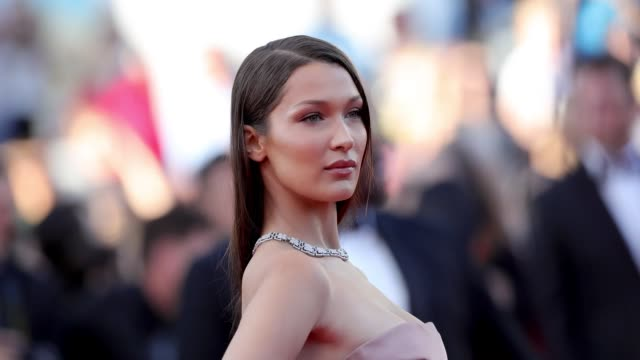 bella hadid poses for photographers at the 'ash is the purest white ' red carpet during the 71st cannes film festival on may 8 2018 in cannes france - bella hadid stock videos & royalty-free footage