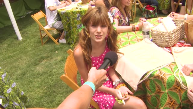 bella thorne and bridgit mendler ryan newman on what they are creating on being here today at the 21st annual 'a time for heroes' celebrity picnic... - a time for heroes stock videos & royalty-free footage