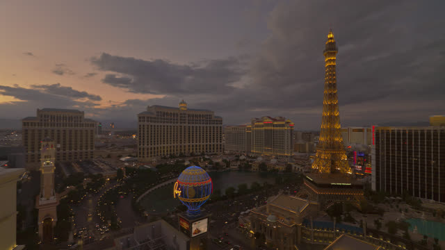 time lapse high angle wide shot bellagio and paris las vegas hotel and casinos from sunset to night - paris las vegas stock videos & royalty-free footage