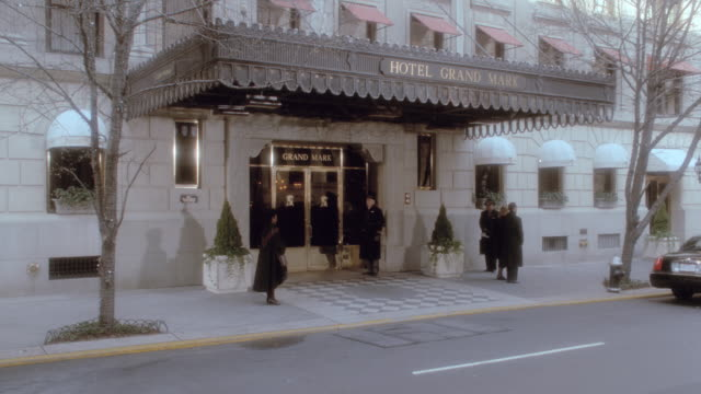 bellhops stand at the entrance to the hotel grand mark in new york. - hotel stock videos & royalty-free footage