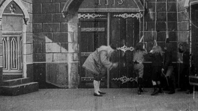 1900 b/w bell-ringers ringing bell at church as worshipers arrive and shake off the snow - bell stock videos and b-roll footage