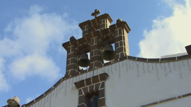 la ms bells on top of small church/ td clock on outside of church/ grand canary, canary islands - grand canary stock videos & royalty-free footage