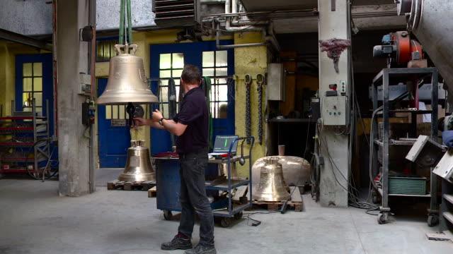 bells production at innsbruck, grassmayr  - north tirol stock videos & royalty-free footage