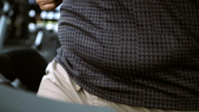 slomo cu belly bouncing during treadmill run - tights stock videos & royalty-free footage
