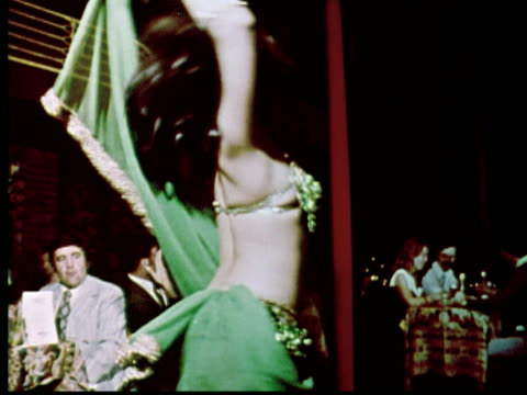 1976 MS Belly dancer twirling / Philadelphia, Pennsylvania, USA
