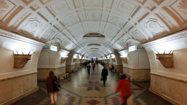 belorusskaya metro station beneath ceiling panels depicting belarussian life, moscow, russia - time lapse - bahnreisender stock-videos und b-roll-filmmaterial