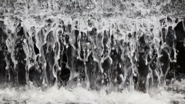 below the waterfall small fish. - jump shot stock videos and b-roll footage