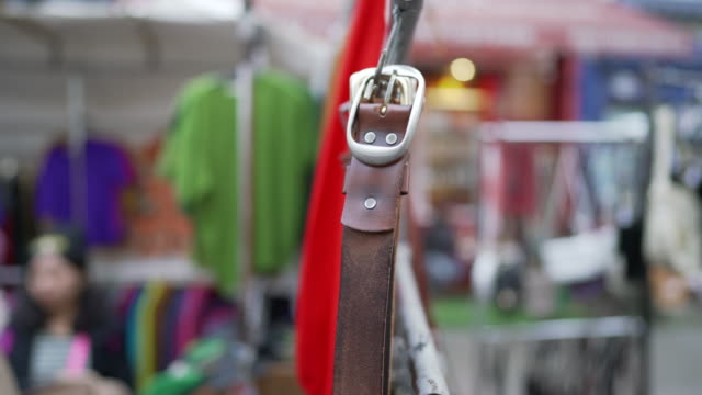 a belt hanging on a market stall in portobello road - notting hill videos stock videos & royalty-free footage