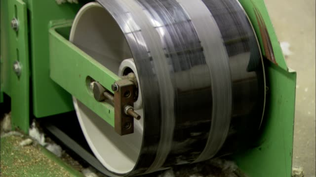 a belt moves along a large roller in a factory. - belt stock videos & royalty-free footage
