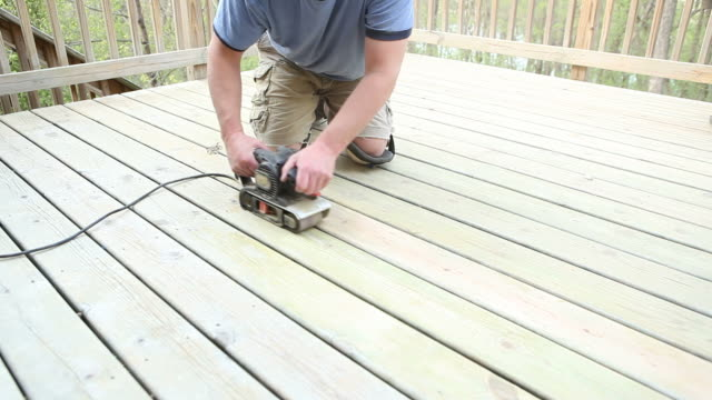 belt sander sanding deck boards - decking stock videos & royalty-free footage