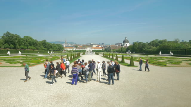 belvedere palace.gardens and tourists. - belvedere palace vienna stock videos & royalty-free footage