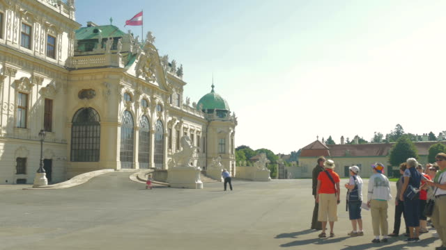 belvedere palace.medium shot with tourist group. - belvedere palace vienna stock videos & royalty-free footage