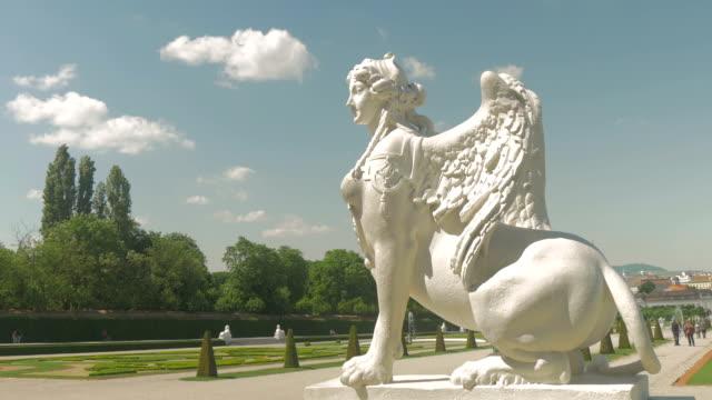 stockvideo's en b-roll-footage met belvedere park with statue and clouds medium shot zoom out. - vrouwelijke gestalte