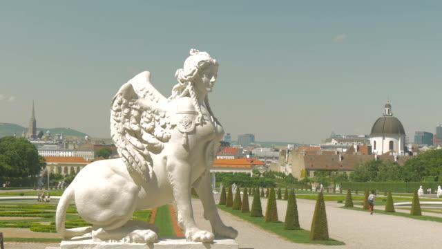 stockvideo's en b-roll-footage met belvedere park with statue medium shot pan r to l. - vrouwelijke gestalte