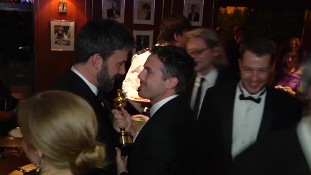 ben affleck and casey affleck at the 2013 vanity fair oscar party hosted by graydon carter inside party footage ben affleck and casey affleck at the... - ben affleck stock videos & royalty-free footage