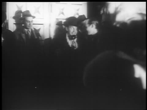 vídeos de stock, filmes e b-roll de ben bernie being interviewed at microphone at jumbo opening / hippodrome theater - 1935