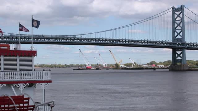 WS Ben Franklin Bridge, with ships sitting on the water in the horizon / Philadelphia, Pennsylvania, United States