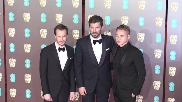 Ben Hardy Gwilyn Lee Joseph Mazzello from The Bohemian Rhapsody film on the red carpet of the 2019 EE British Academy Film Awards in London London UK...