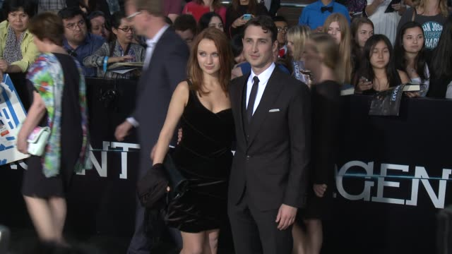 """ben lloyd-hughes and emily berrington at the """"divergent"""" los angeles premiere at regency bruin theatre on march 18, 2014 in los angeles, california. - emily berrington stock videos & royalty-free footage"""
