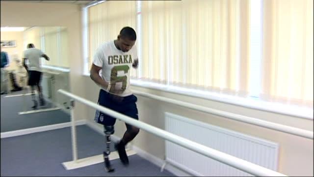 ben mcbean jogging through parallel bars at rehabilitation centre - parallelo video stock e b–roll