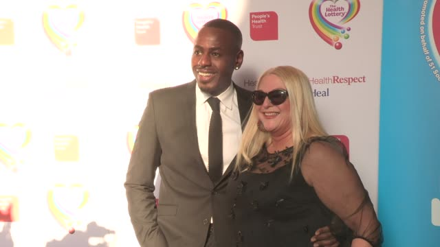 stockvideo's en b-roll-footage met ben ofedu; vanessa feltz at health lottery launch at claridge's hotel on march 28, 2013 in london, england - vanessa feltz