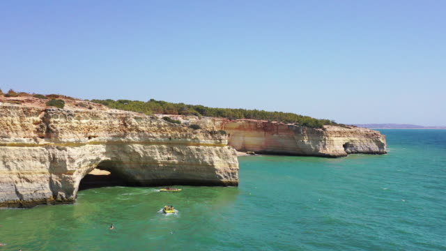 benagil's beach / algarve, portugal - natural arch stock videos & royalty-free footage