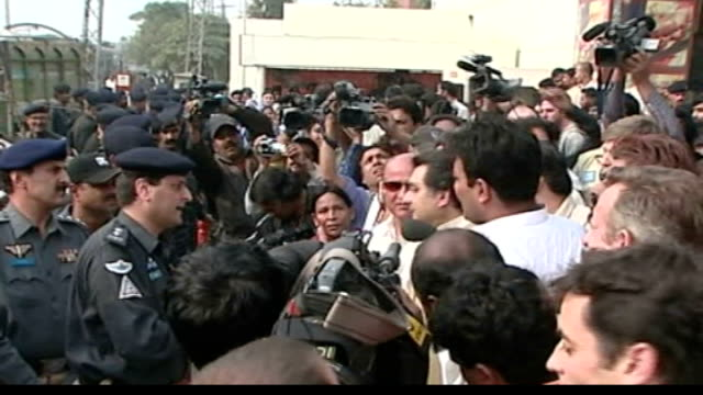 benazir bhutto calls for resignation of president pervez musharraf pakistan lahore ext armed police manning barricades outside home of benazir bhutto... - lahore stock videos and b-roll footage