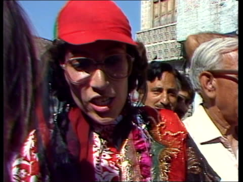 benazir bhutto greeted by enthusiastic supporters pakistan rawalpindi crowd cheering sof and waving flags pan lr tms crowd applauding ms people on... - zia stock videos & royalty-free footage
