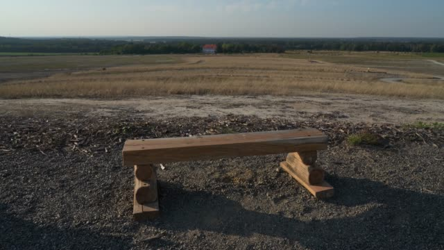 a bench for visitors stands on a landscaped portion of land that was once torn open by the welzow sued openpit coal mine and is now undergoing... - landscaped stock videos & royalty-free footage