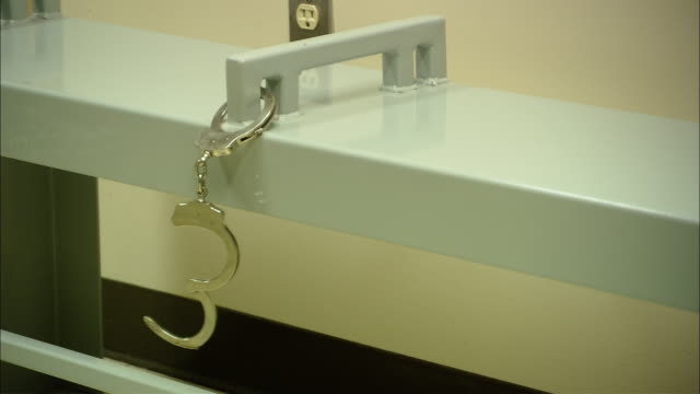 CU Bench in police station with dangling handcuffs attached/ New Jersey
