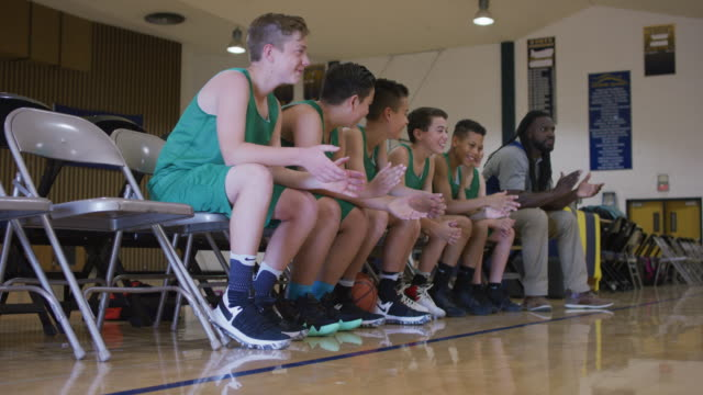 bench of elementary basketball team clapping - bench stock videos & royalty-free footage