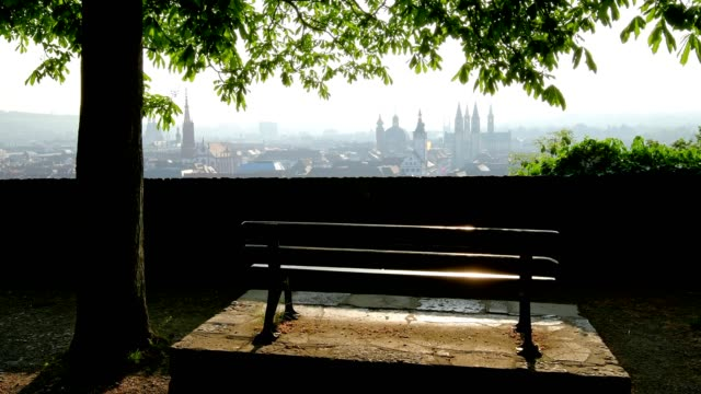 bench on marienberg castle and view over old town and churches of würzburg, franconia, bavaria, germany - wurzburg stock videos and b-roll footage
