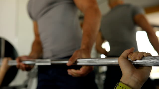 Bench press exercise with fitness trainer
