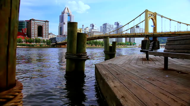 benches on the wooden pier opposite pittsburgh cityscape. - waterfront stock videos & royalty-free footage