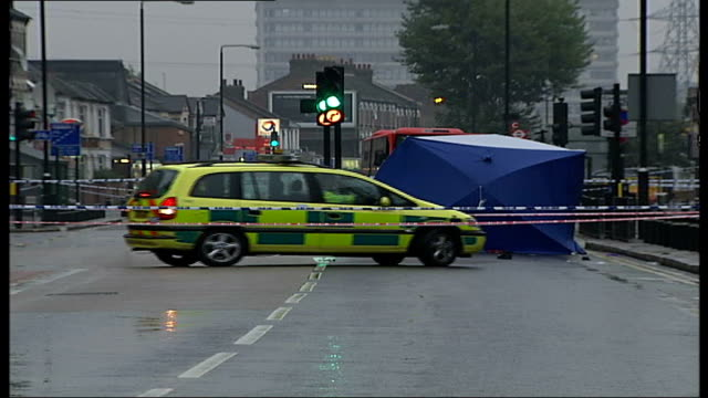 bendy bus safety questioned after fatal accident; ilford: police vehicles and forensic tent in road at scene of bendy bus accident in which lee... - ilford stock videos & royalty-free footage