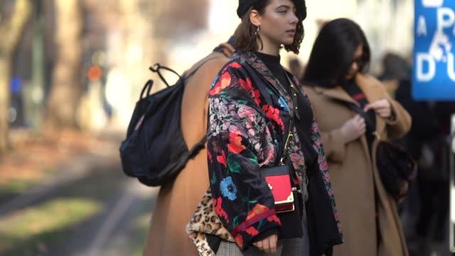 benedetta longobardi wears a prada bag, a beret hat, a flower print silk kimono jacket, outside dolce gabbana , during milan menswear fashion week... - dolce & gabbana stock videos & royalty-free footage