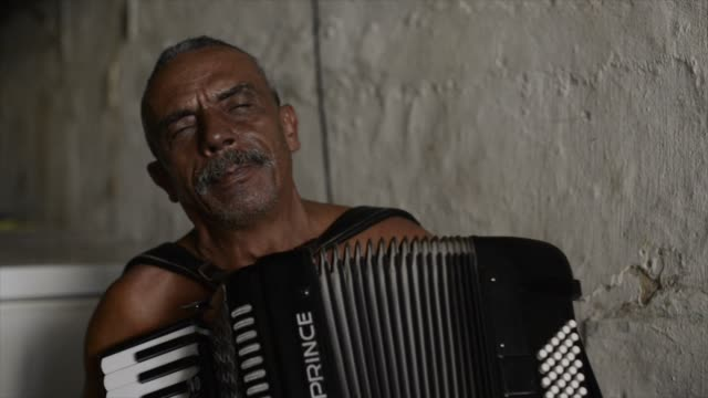 benedetto da macuca is a local celebrity, a musician known in olinda and most of the northeastern parts of brazil. he casualy plays on the accordion... - ドキュメンタリー映画点の映像素材/bロール