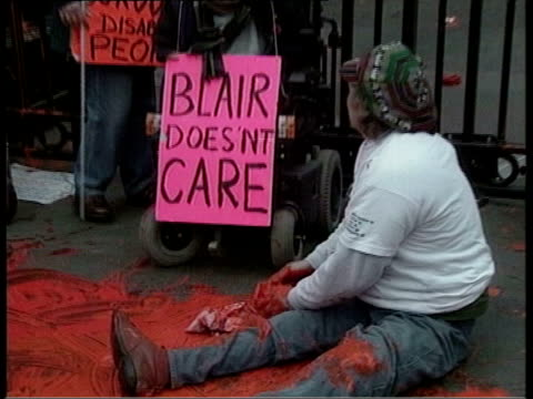 alleged clash between tony blair and david blunkett; tx disabled activists protesting at westminster over plans to reform the welfare state - david blunkett stock videos & royalty-free footage