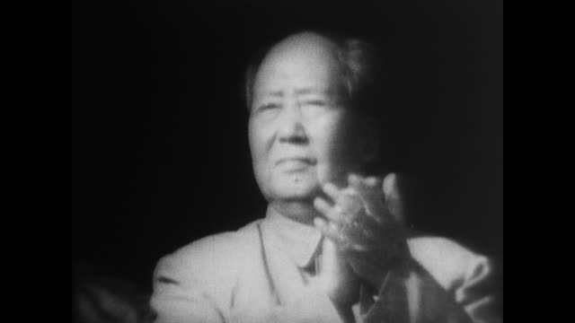 benevolent chairman mao enjoys the cheering of the crowd before applauding and smiling back - mao tse tung video stock e b–roll