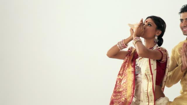 bengali couple praying  - conch stock videos & royalty-free footage