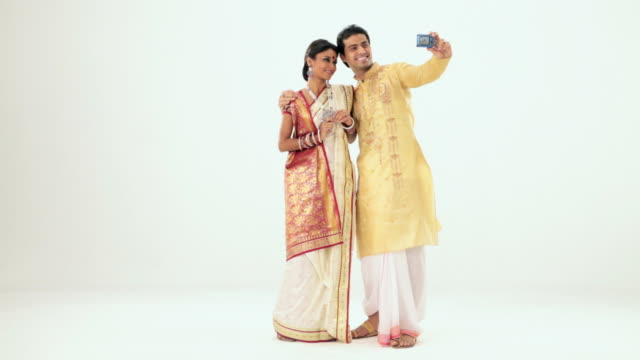 bengali couple taking picture of themselves with a digital camera - dhoti stock videos & royalty-free footage