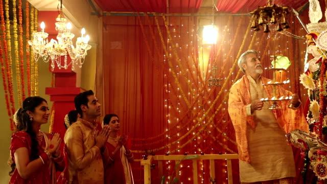 Bengali priest worshipping in durga puja festival, Delhi, India