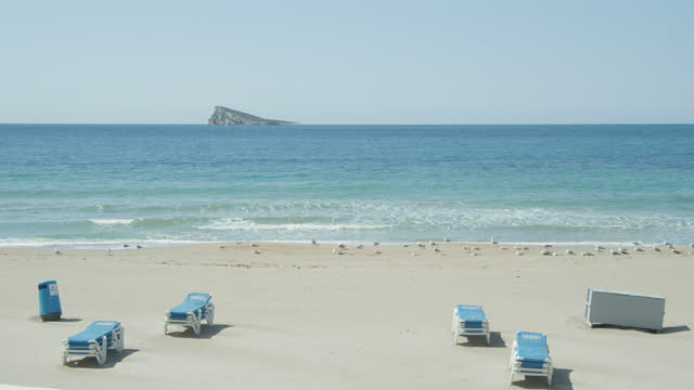 benidorm beach at spain with no people. 2020 lockdown state of emergency - blue stock videos & royalty-free footage
