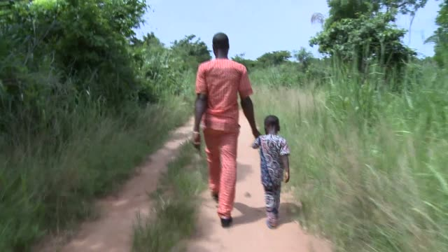 benin_afrika_natives father and son countryroad - modern manhood stock videos & royalty-free footage