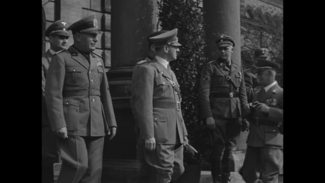 benito mussolini and adolf hitler walk in munich followed by hermann goering and heinrich himmler / hitler and mussolini walk past lines of german... - adolf hitler stock-videos und b-roll-filmmaterial