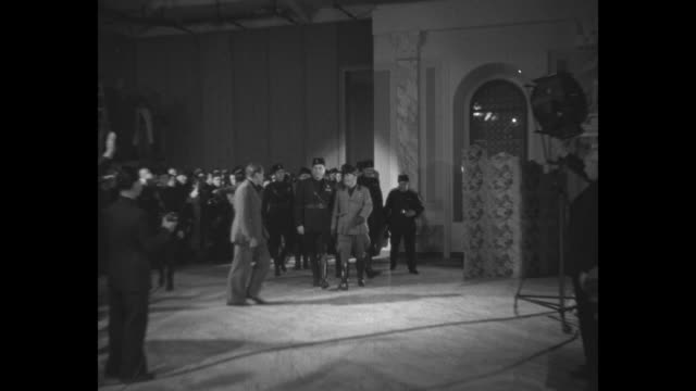 benito mussolini and entourage entering a soundstage at the motion picture production center cinecitta studios as they tour the facility after... - benito mussolini stock videos & royalty-free footage