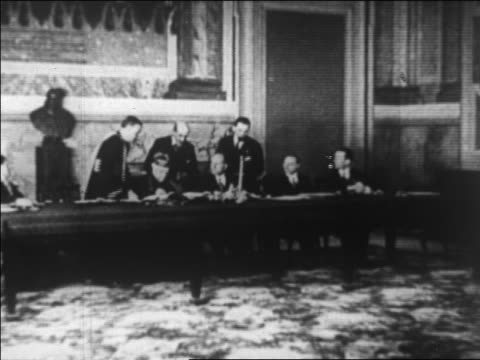 vídeos de stock, filmes e b-roll de benito mussolini cardinal gasparri signing lateran treaty - benito mussolini